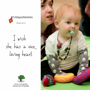 """Child and baby sitting. The caption reads """"I wish she has a nice, loving heart"""""""