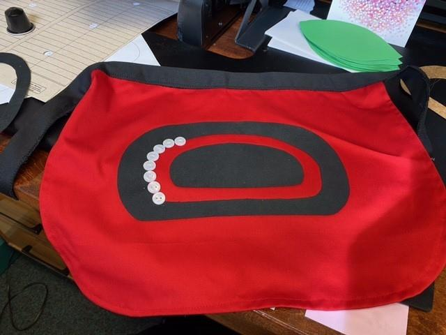 Button Apron being made for Baby Marlo by Instructor Tawni Davidson.