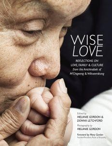 Wise Image book cover. An Elder kisses the hand of a baby out of frame. Reflections on Love, Family, and Culture.